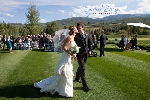Aspen wedding photography snowmass club bride and groom kissing