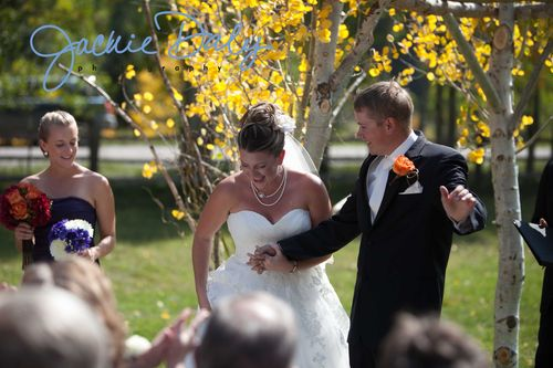 aspen wedding photography T Lazy 7 Ranch ceremony post kiss cheers