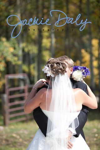 aspen wedding photography T Lazy 7 Ranch Husband and wife hug post ceremony