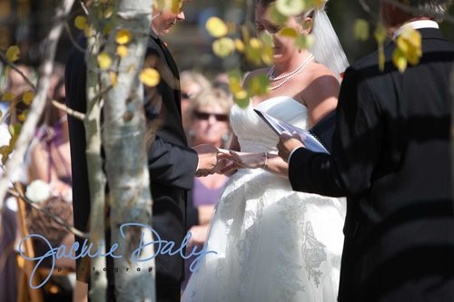 aspen wedding photography T Lazy 7 Ranch ceremony exchange the rings