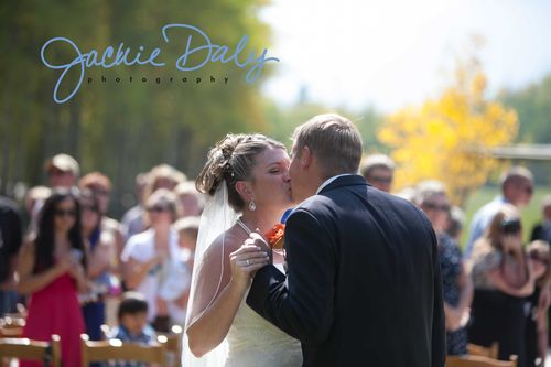 aspen wedding photography T Lazy 7 Ranch post ceremony kiss