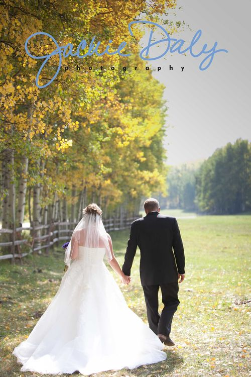 aspen wedding photography T Lazy 7 Ranch bride and groom strolling away